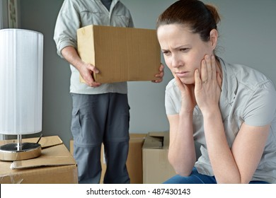 Upset woman (age 30-40) when her partner is move out from home. Moving house concept. Real people. copy space