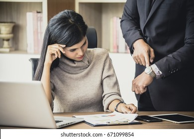 Upset woman being scolded by boss for working at office, Boss showing time for deadline job, woman with stressful concept, vintage tone.