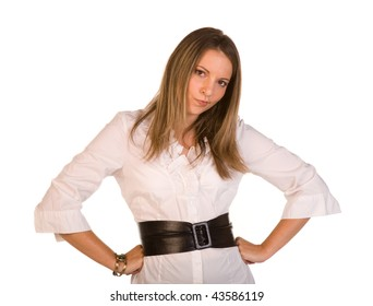 upset woman staring forward with hands on hips