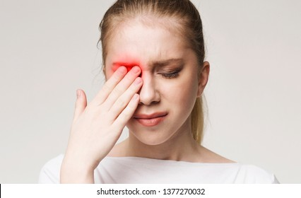 Upset woman suffering from strong eye pain. Healthcare concept, panorama