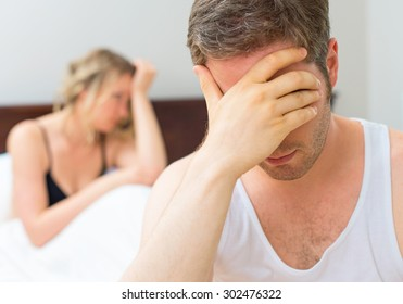 Upset young couple having problems with sex.