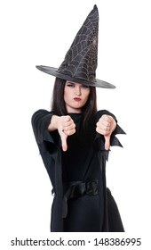 Upset young witch shows gesture that you are a loser over white