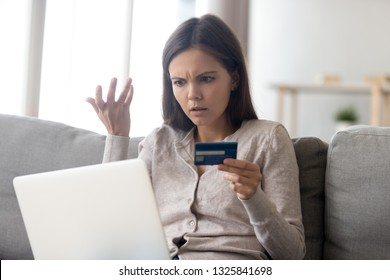 Upset young woman using online banking service, problem with blocked credit card, using laptop, irritated girl checking balance, internet fraud concept, bankruptcy or debt, overspend