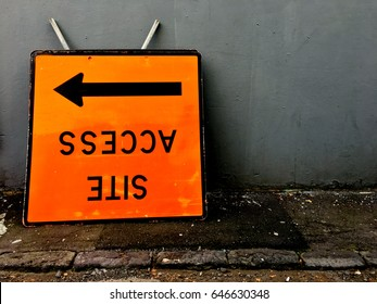 Upside down access site sign with arrow. Construction and housing market concept.  copy space