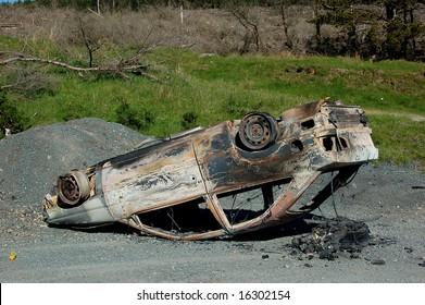 upside down burned out car