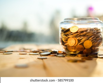 Upside down the jar of coins on the wooden background, bankruptcy or loss concept
