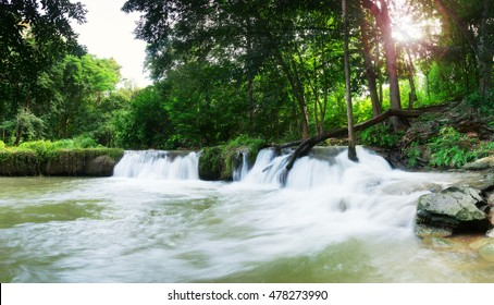 Upstream waterfall in the forest with green trees in the rainy season,Beautiful waterfall in Thailand