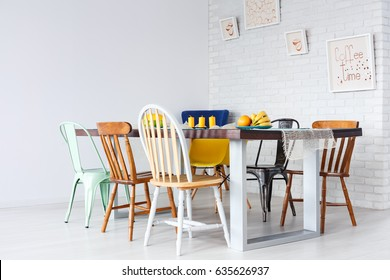 Up-to-date simple design of dining room with wooden table and chairs