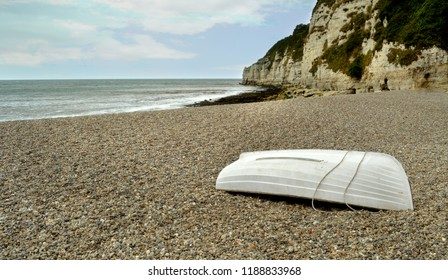 upturned boat on beach.branscombe devon