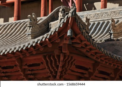 Upturned eaves on tiled roof with dragon figures-9 story high wooden porch of cave 96-Mogao Caves S.area with 492 caves and cell temples dating from centuries 4th to 14th. Dunhuang-Gansu prov.-China.