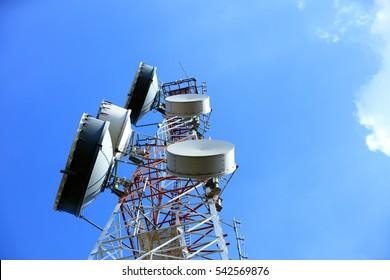 upward of Communication  Radio antenna Tower , microwave antenna tower on blue sky background