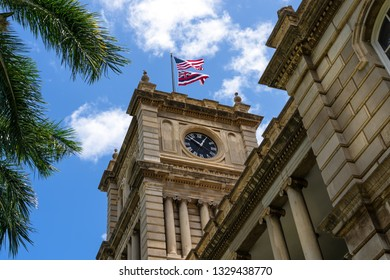 Upward view of the clock tower on the supreme court building in Honolulu Hawaii - Ali'iolani Hale