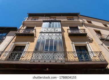 Upward view of the facade of a buildling in the city of Salamanca, Spain