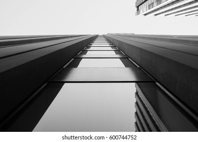 upward view of modern skyscraper and it's glass window