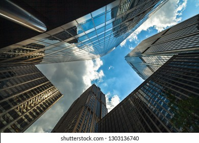Upward view of modern skyscrapers in downtown Chicago.