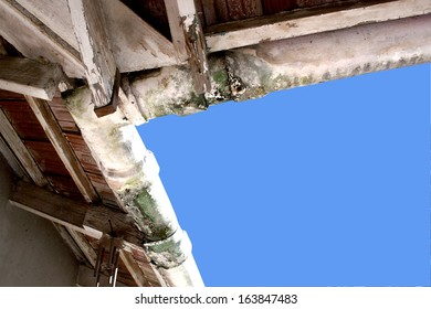 upward view of moldy neglected asbestos guttering