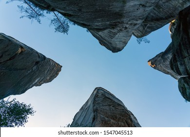 Upward view of the sky in the shape of the letter X. Stone city Adrspach, Teplice, Czech Republic, Europe.