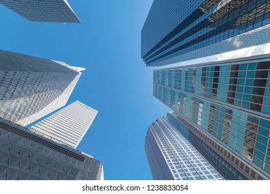 Upward view of skyscrapers against blue sky in the business district area of downtown Dallas, Texas, USA.