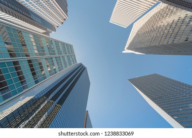274e94f002a1 Upward view of skyscrapers against blue sky in the business district area  of downtown Dallas