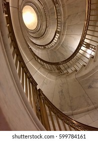 Upward View of Spiral Staircase With Marble Interior