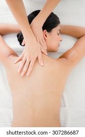 Upward view of woman receiving back massage at spa center