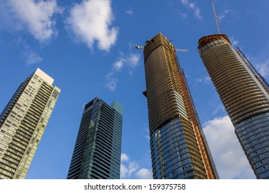 An upwards perspective of condos being constructed in Canada