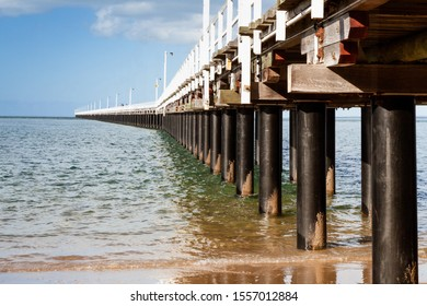 Urangan Pier, Queensland Australia - October 2019: Stretching almost a kilometre into the ocean, the historic and famous pier is a well known landmark and worth the walk to the end.
