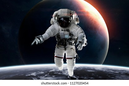 Uranus with astronaut in front of planet. Solar system. Elements of this image furnished by NASA