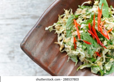 Urap, an Indonesian-style salad, served with herbs and red chillies.