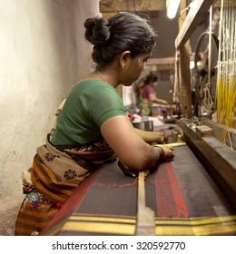 URAVAKONDA,INDIA-CIRCA 2014 - An unidentified lady weaving a silk saree in Uravakonda