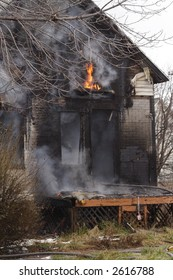 Urban abandoned  Detroit House on fire in the winter