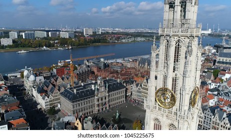 Urban aerial photo of Antwerp The Cathedral of Our Lady tower in Dutch Onze-Lieve-Vrouwekathedraal is Roman Catholic cathedral Antwerp Belgium also showing Scheldt river City Hall and Guildhalss