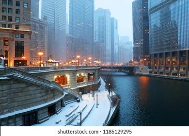 Urban architecture background, big city life concept. Beautiful Chicago downtown cityscape twilight winter view during snowfall. Illinois, Midwest USA.
