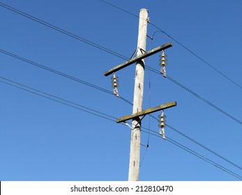 urban area power lines in dark blue sky close up for electricity network and technology improving