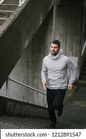 Urban athlete running on stairs. Sporty man training outside