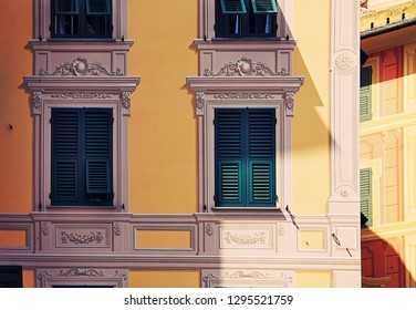 Urban atmosphere, Ligurian painted houses with forced perspective decorations around windows, like the backstage of a theater
