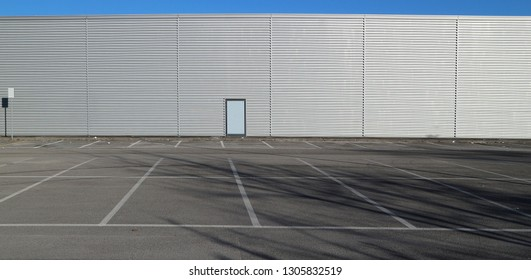 Urban background and copy space. Empty parking in front of an aluminium cladding modern building