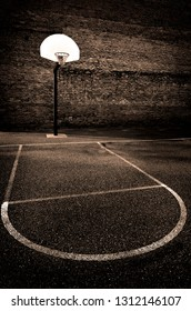 Urban basketball outdoors street ball in the hood park asphalt