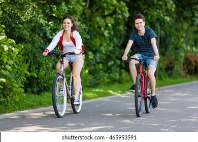 Urban bicycle - teenage girl and boy cycling