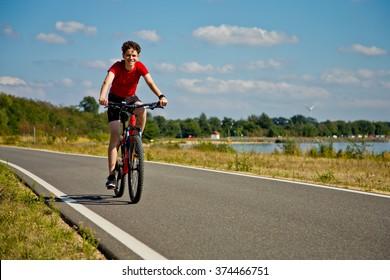Urban biking - teenage boy riding bike