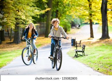 Urban biking - teens and bikes in city park