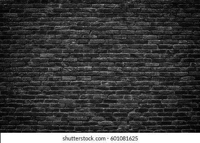Urban black brick wall texture old masonry background