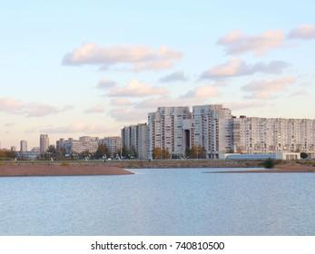 urban blocks high-rise buildings on the beach at sunset