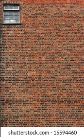 urban brick wall texture background with small window in top right corner