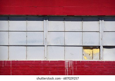urban building with broken and painted windows