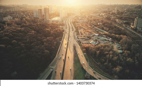 Urban Car Road Traffic Congestion Aerial View. City Street Motion Lane, Drive Navigation Overview. Busy Cityscape Speed Route with Forest Park Around. Travel Concept Drone Flight Shot