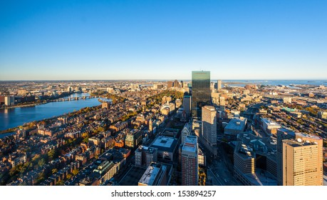 Urban city aerial panorama view. Boston aerial view with skyscrapers at sunset with city downtown skyline.