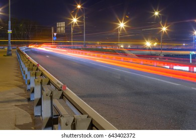 Urban city road with car light trails at night