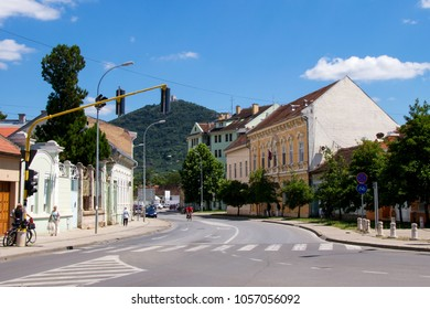The urban cityscape of the road, street, old hitorical architecture, traffic, cars, bicycle and pedestrian in Vrsac - beautiful Balkan city on the border betweeen Serbia and Romania