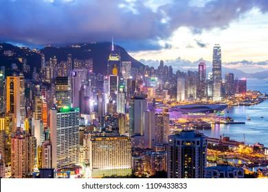 Urban cityscape skyline at night in Hong Kong